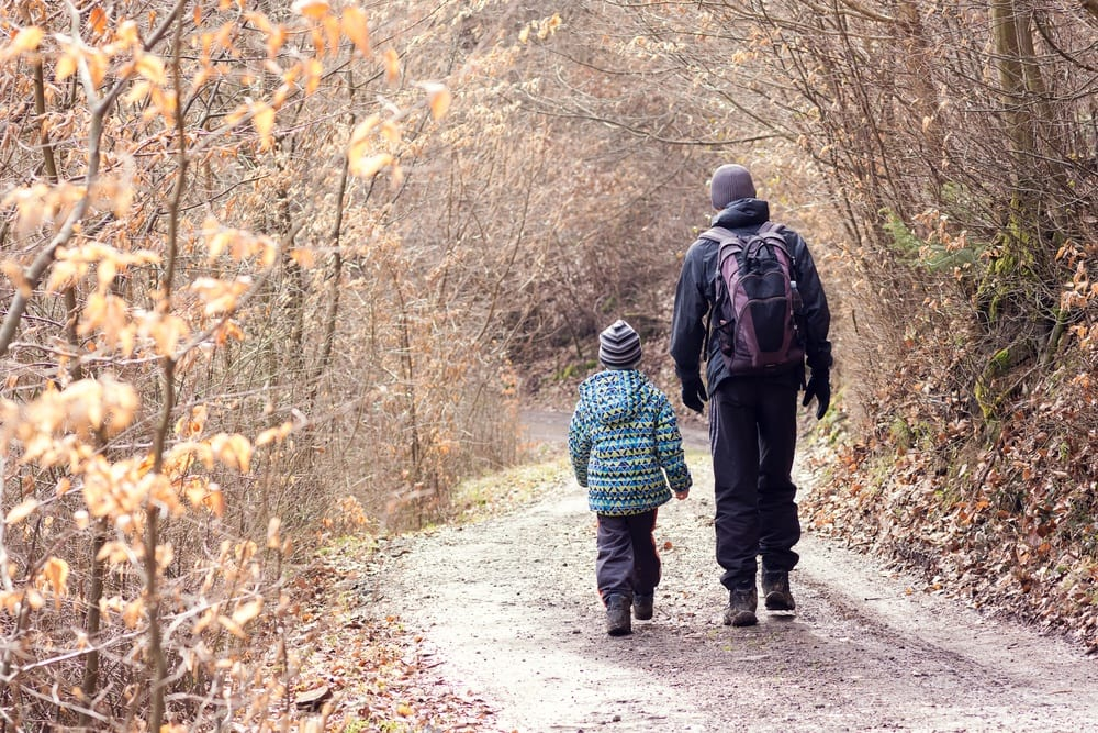 Father & son taking a walk in the winter