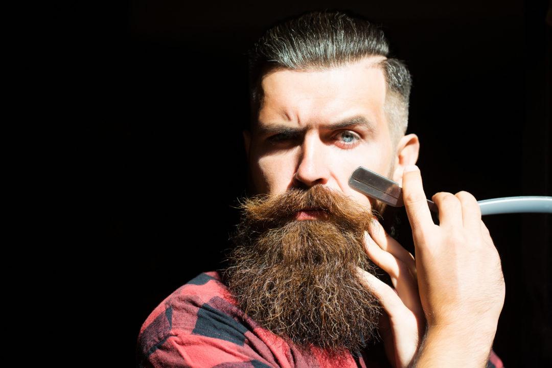 Man styling his beard