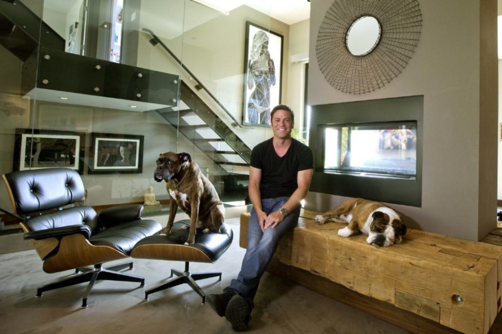 Actor Yannick Bisson pictured in his home with his dog next to him