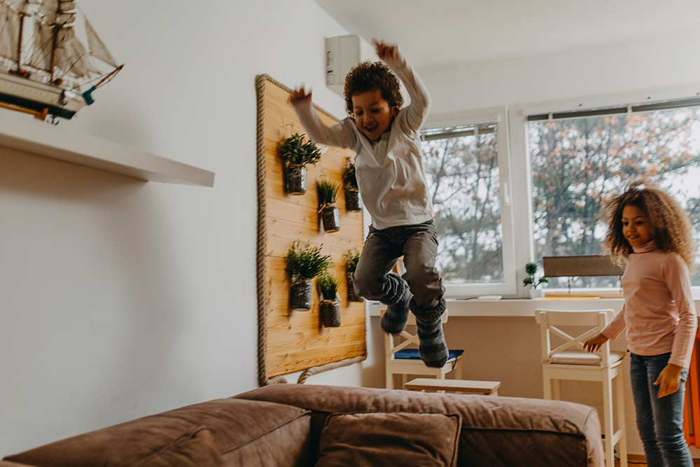 Kids jumping on the living room couch