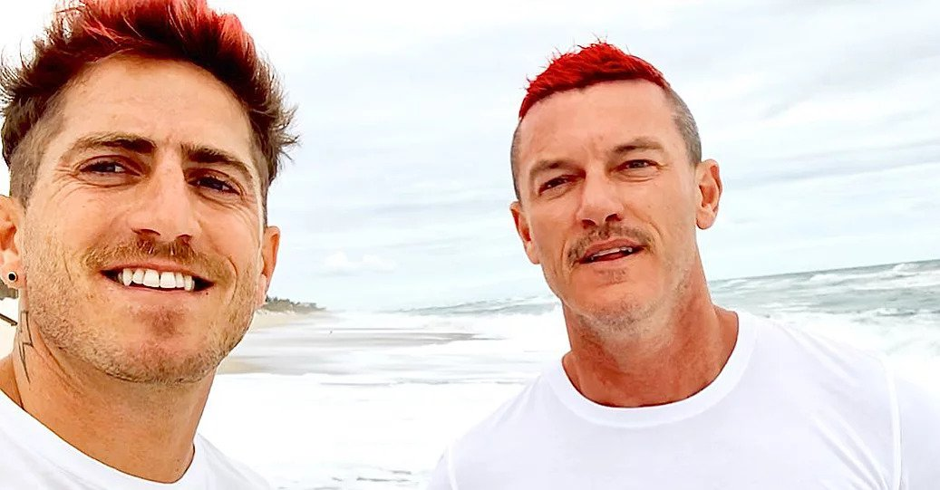Luke Evans and his neon red hair