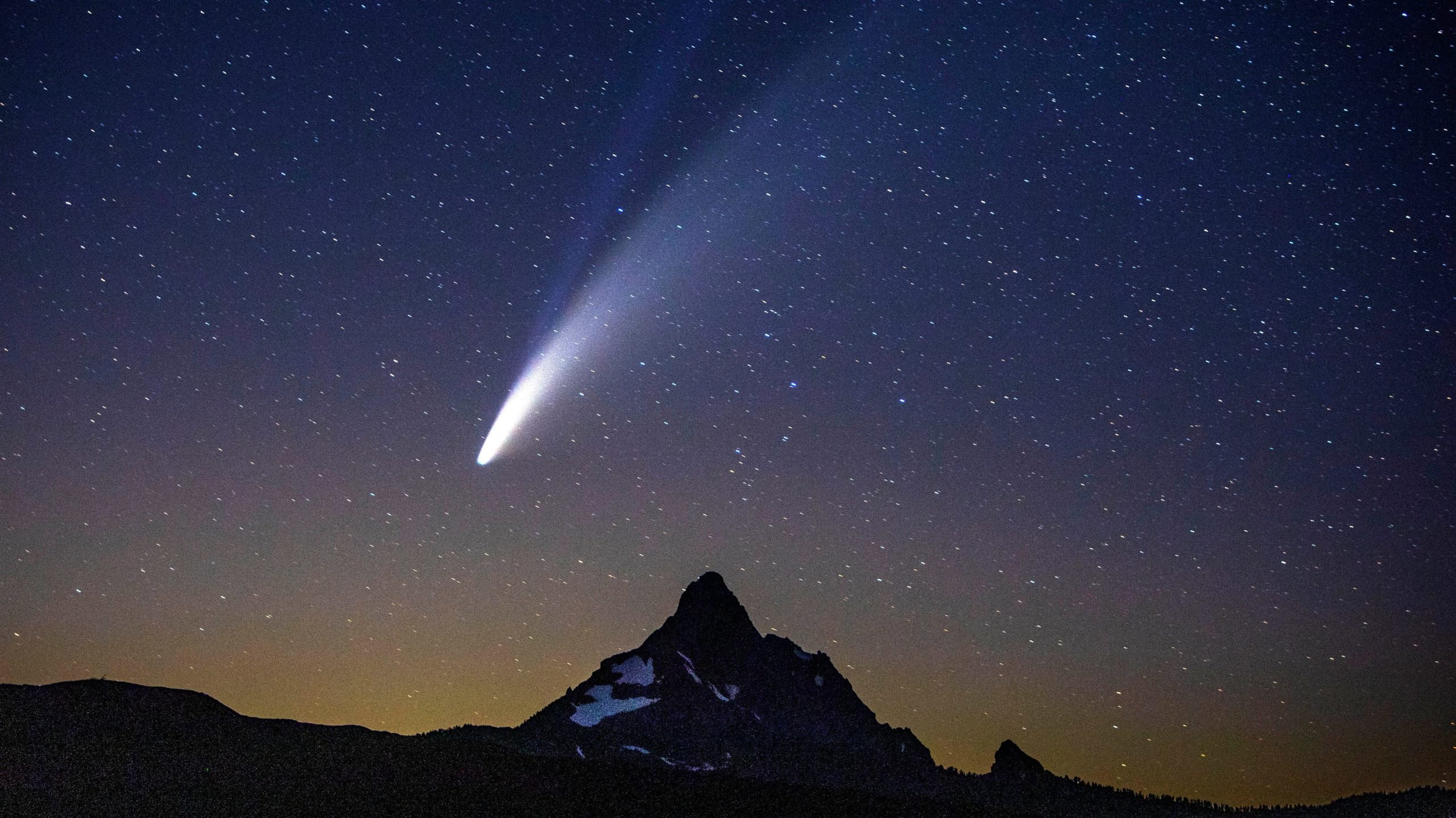 Mountain landscape, night sky, comet Neowise passing