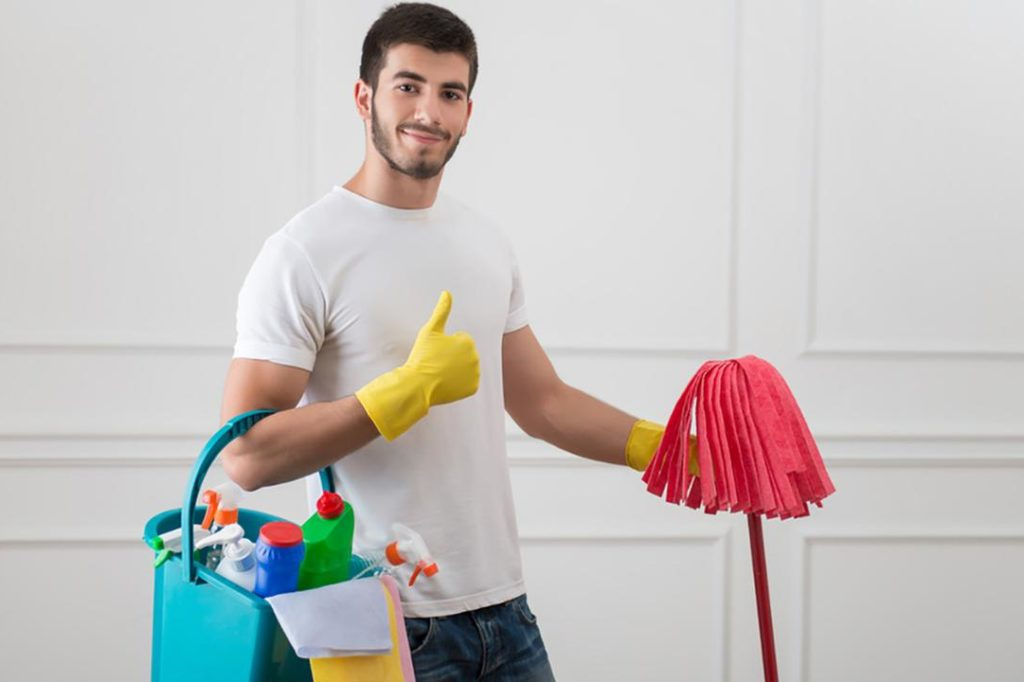 Man with housework cleaning equipment, thumbs up