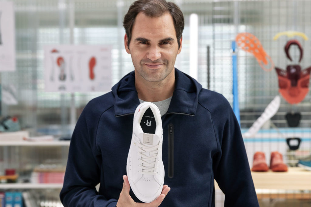 Roger Federer Holding His New Sneakers