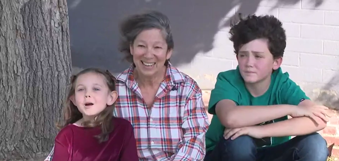 A picture of the family who found Foxy: two kids and their grandma