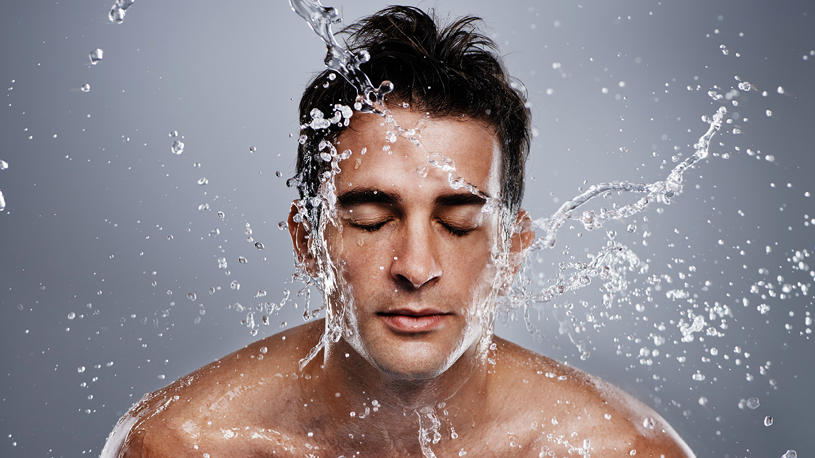 Man splashing water on his face
