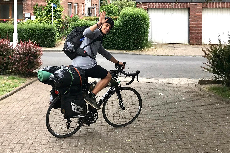 Kleon on his bike, waving at the camera