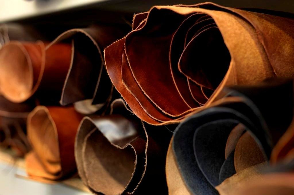 Sheets of rolled leather pictured up close