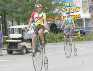Randy Oleynik and his daughter riding their bikes in town