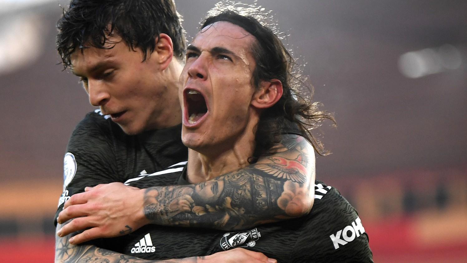 Uruguay striker Edinson Cavani celebrating a goal with Swedish defender Victor Lindelöf