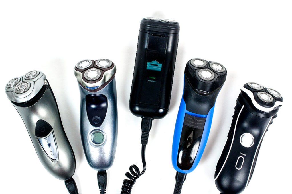 Five Electric Razors With Cords Isolated on White