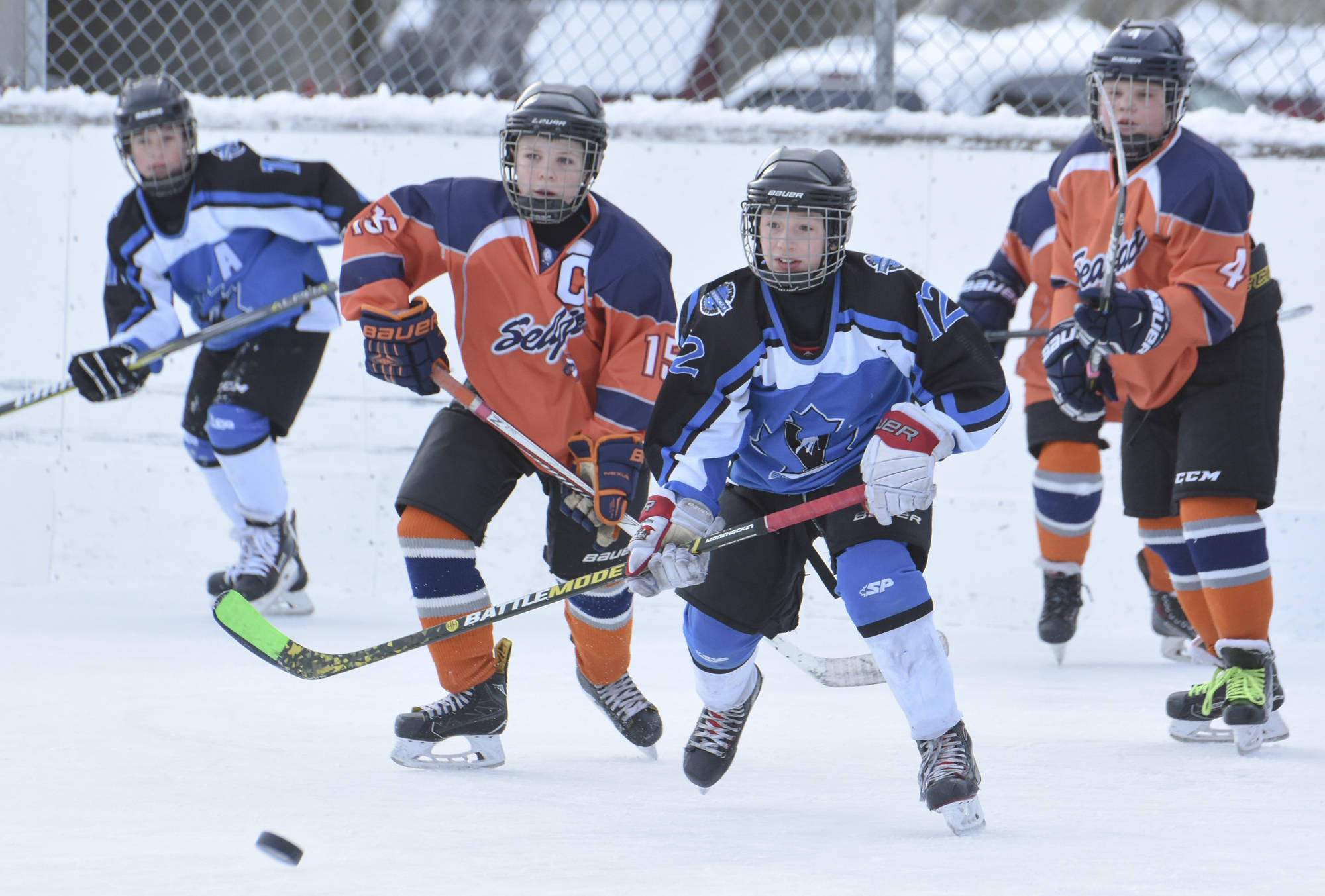 young boys playing hockey