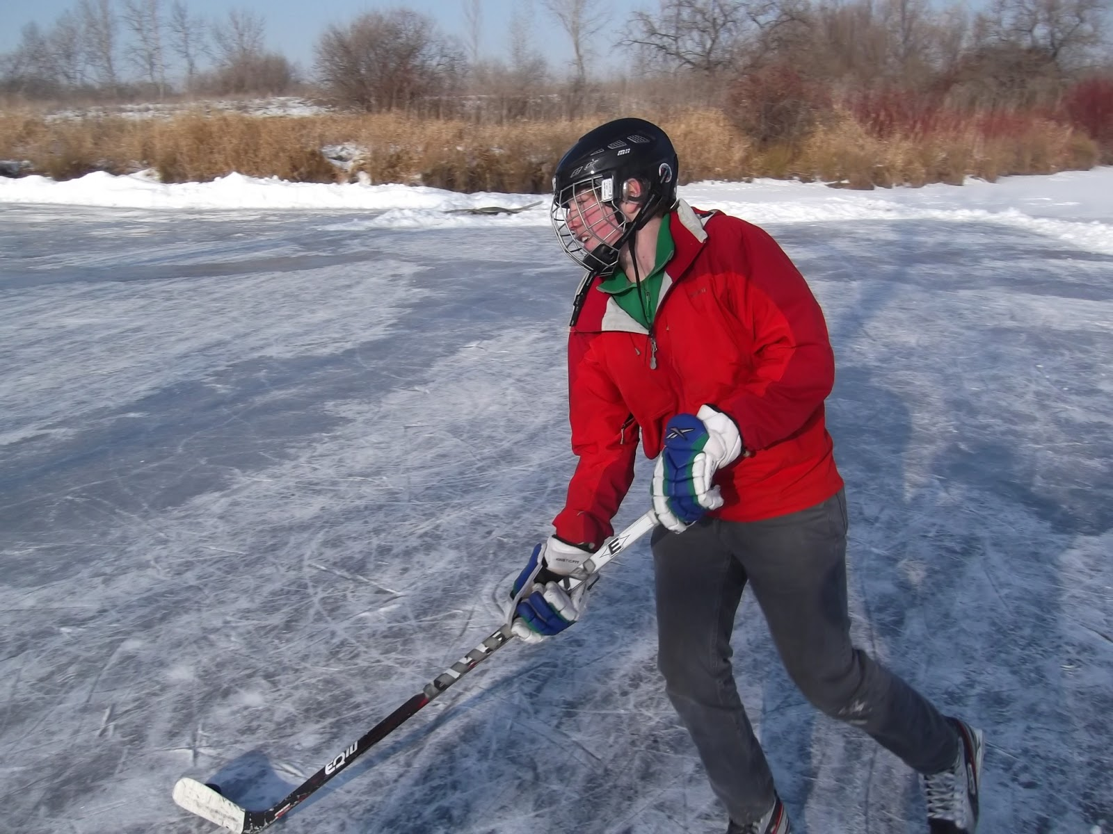 The oldest son, Christian, playing hockey on the ice rink