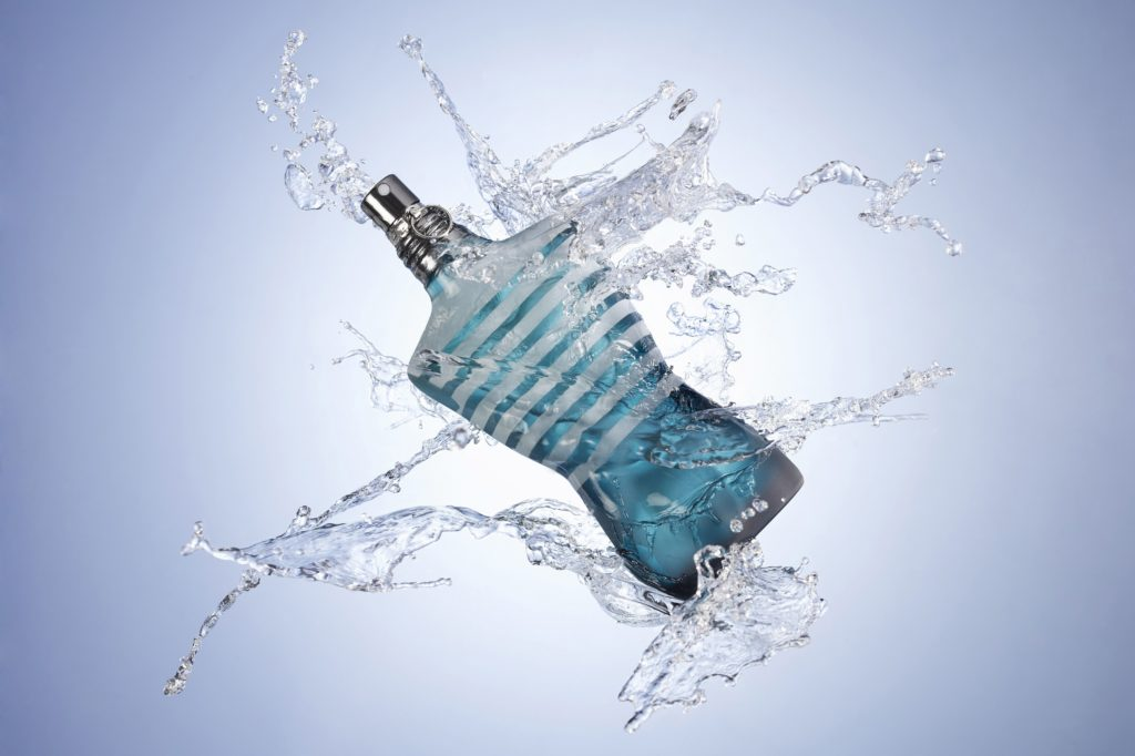 An aquatic cologne splashed with water